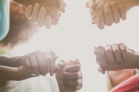 praying hands in light